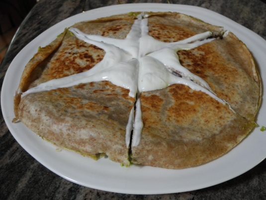 for a pretty presentation. put the dollup of Greek yogurt on the quesadilla before you cut it,