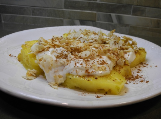 Grilled pineapple, sweetened with Greek yogurt, cinnamon &almonds