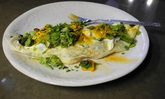 Home-made yogurt tops off this veggie omelet well