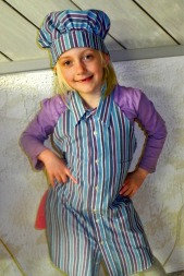 Apron and chef hat modeled by ISLA, 6 years old