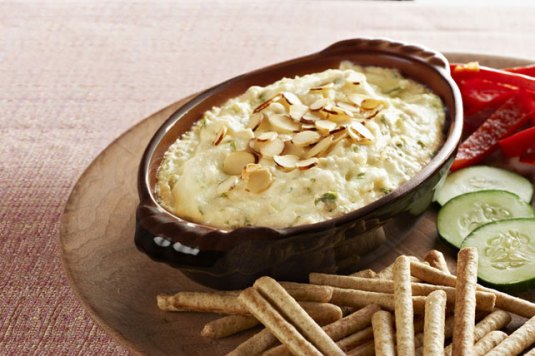 Serve a hot bowl of crab dip with veggies and crackers.